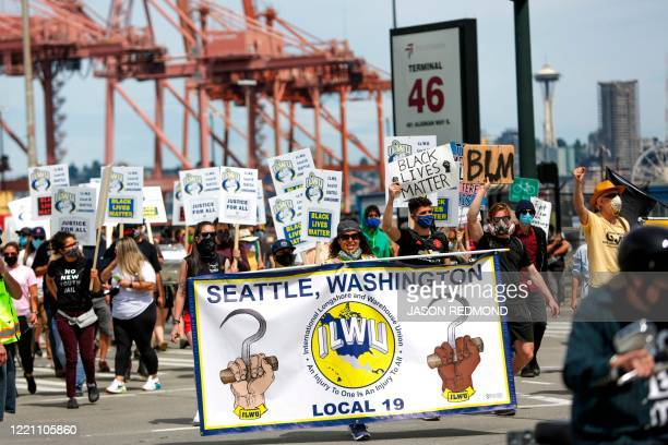Demonstrators march from Terminal 46 during the Juneteenth Shutdown of All Pacific Coast Ports rally and march event organized by Seattle's A Philip...