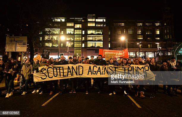Demonstrators march from the Mound to the Scottish Parliament to protest against US President Trump's Muslim travel ban to the USA on January 30 2017...