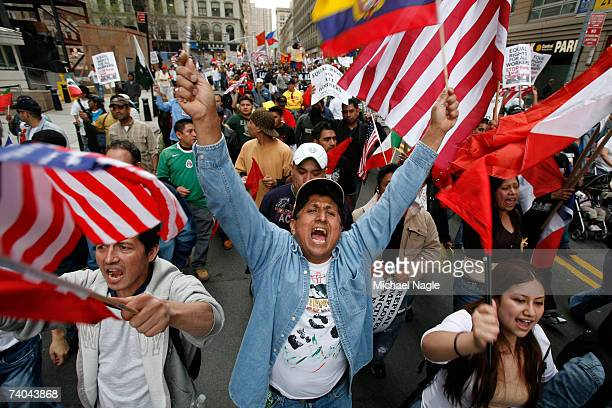 Demonstrators march from Union Square to Foley Square during an immigration reform rally on May 1 2007 in New York City The protest was one of many...