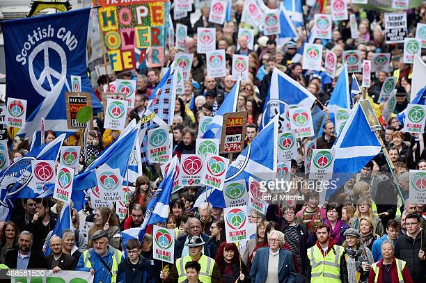 Demonstrators march in Glasgow to call for the scrapping of Britain's Trident nuclear weapons programme on April 4 2015 in Glasgow Scotland Thousands...