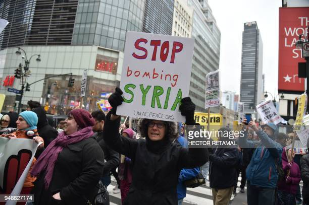 TOPSHOT Demonstrators march in New York on April 15 during the March to End US Wars at Home and Abroad