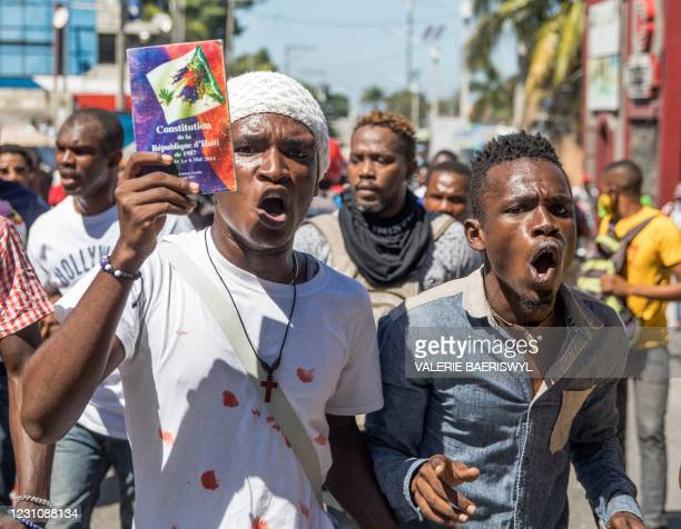 Demonstrators march in Port-au-Prince on February 10 to protest against the government of President Jovenel Moise. - Haitian police fired tear gas on...