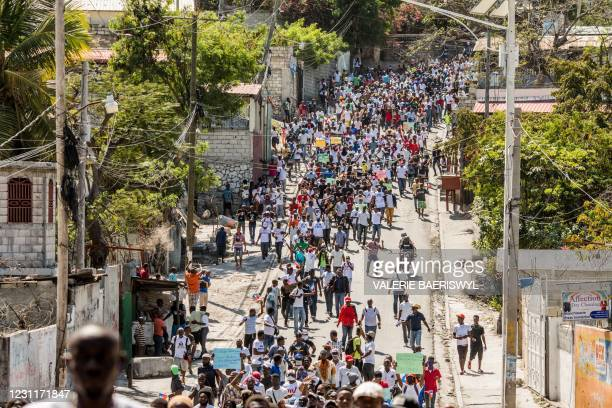 Demonstrators march in Port-au-Prince on February 14 to protest against the government of President Jovenel Moise. - Several thousand people...