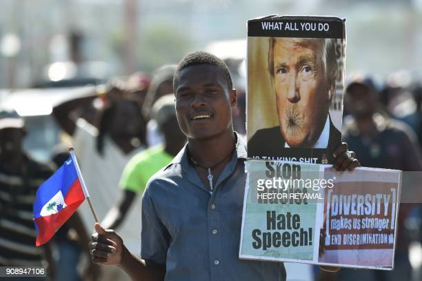 Demonstrators march in PortauPrince on January 22 during a protest against the disparaging comments made by US President Donald Trump against Haiti...
