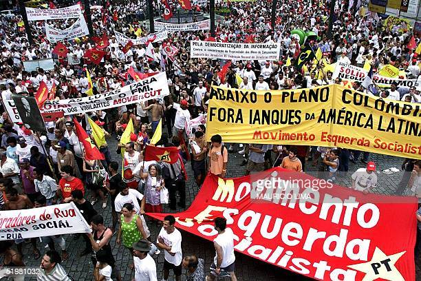 Demonstrators march in Porto Alegre Brazil 25 January during the opening of the World Social Forum an alternative gathering to the World Economic...
