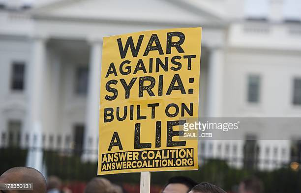 Demonstrators march in protest during a rally against a possible US and allies attack on Syria in response to possible use of chemical weapons by the...