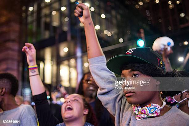 Demonstrators march in protest on September 22 2016 in Charlotte NC Protests began on Tuesday night following the fatal shooting of 43yearold Keith...