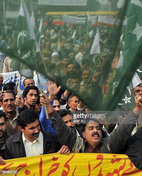 Demonstrators march in support of the Pakistan army during a protest against terrorism in Lahore on December 15 2009 At least 12 people were killed...