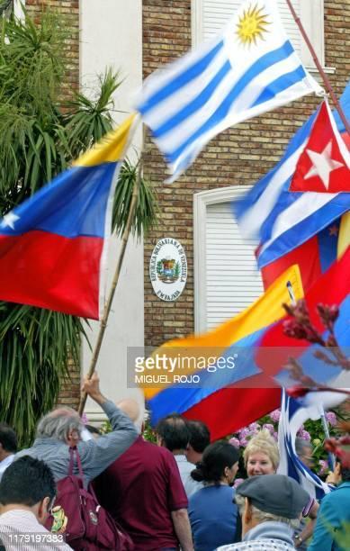 Demonstrators march in support of Venezuelan President Hugo Chavez in front of the Venezuelan embassy in Montevideo Uruguay 13 December 2002...