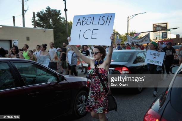 Demonstrators march in the Little Village neighborhood calling for the elimination of the US Immigration and Customs Enforcement and an end to family...