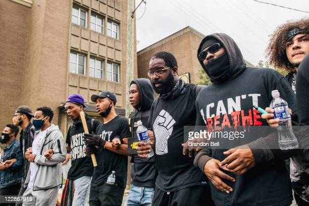 Demonstrators march in the street following the grand jury verdict on September 23, 2020 in Louisville, Kentucky. Protesters marched in the streets...