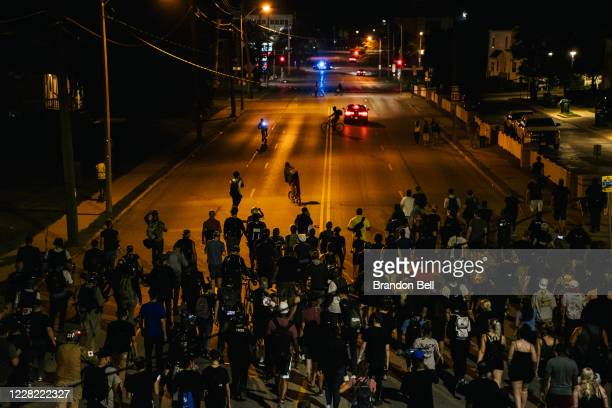Demonstrators march in the streets on August 26, 2020 in Kenosha, Wisconsin. As the city declared a state of emergency curfew, a fourth night of...