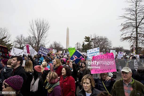Demonstrators march near the Washington Monument during the Women's March on Washington in Washington, D.C., U.S., on Saturday, Jan. 21, 2017. The...