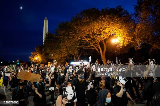 Demonstrators march near the White House in protest following a Kentucky grand jury decision in the Breonna Taylor case on September 23 2020 in...