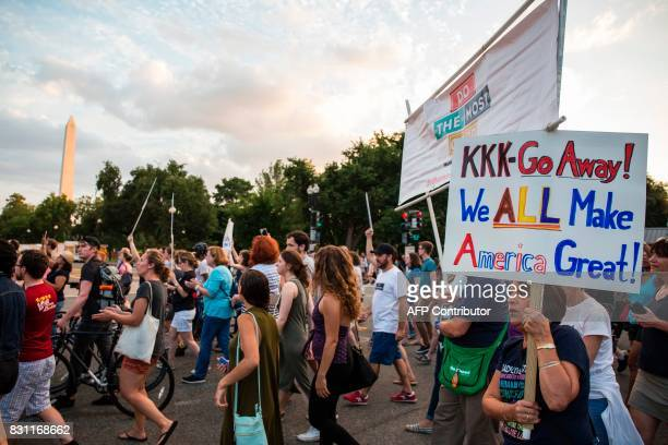 Demonstrators march on August 13 2017 in Washington DC to a statue of Confederate General Albert Pike the only member of the Confederate military...