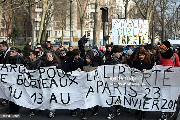 Demonstrators march on January 23 from the Hyper Casher shop in Paris, toward the satirical newspaper Charlie Hebdo offices in Paris, two weeks after...