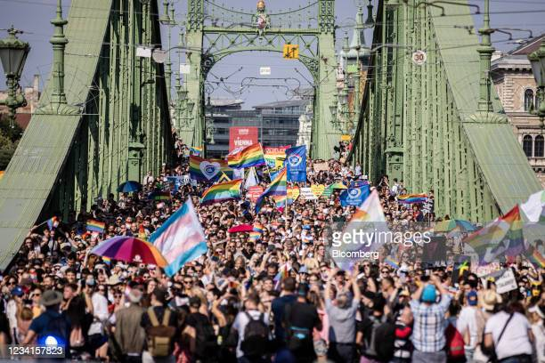 Demonstrators march on Liberty Bridge during the annual Pride parade in Budapest, Hungary, on Saturday, July 24, 2021. Brussels isthreatening...