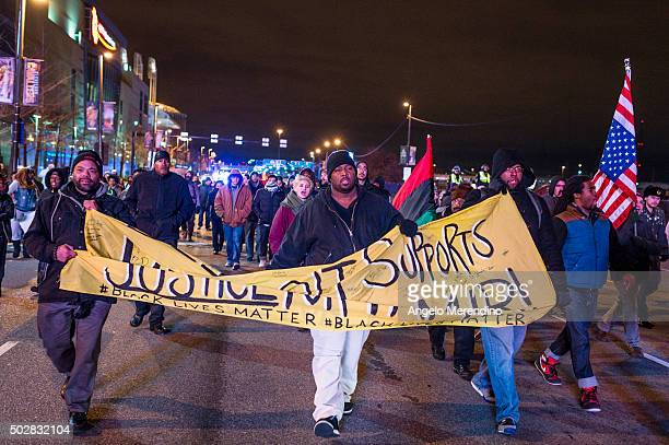 Demonstrators march on Ontario St on December 29 2015 in Cleveland Ohio Protestors took to the street the day after a grand jury declined to indict...