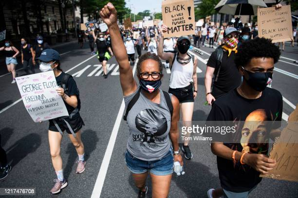 Demonstrators march on Pennsylvania Avenue towards the Capitol to protest the death of George Floyd on Wednesday June 3 2020