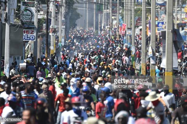 Demonstrators march on the streets on the fifth day of protests in PortauPrince February 11 against Haitian President Jovenel Moise and the misuse of...