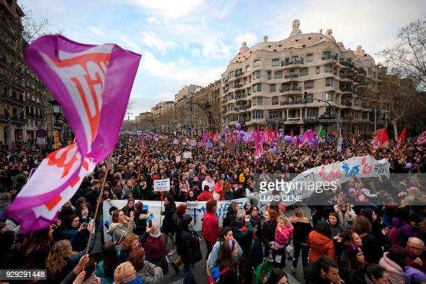 Demonstrators march past Spanish architect Antonio Gaudi's Casa Mila 'La Pedrera' building during a demonstration to defend women's rights on...