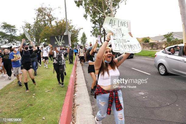 Demonstrators march the streets in Cerritos on Monday June 1 2020