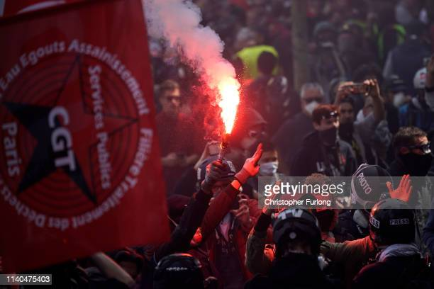 Demonstrators march though Paris as they take part in the annual May Day protests on May 01 2019 in Place D'Italie Paris France More than 7400 police...