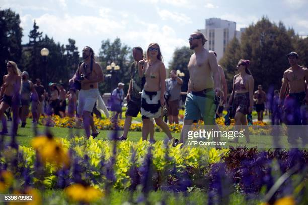Demonstrators march through Civic Center Park in during the 2017 GoTopless Day Parade on August 26 2017 in Denver Colorado Founded in 2007 by the...