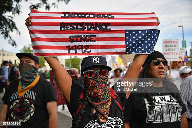 Demonstrators march through downtown ahead of the Republican National Convention on July 17 2016 in Cleveland Ohio An estimated 50000 people are...