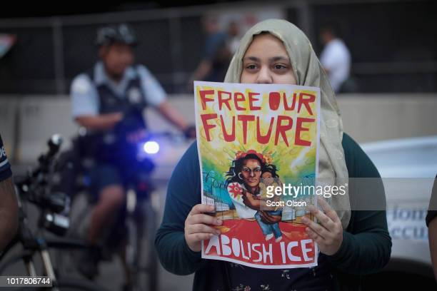 Demonstrators march through downtown calling for the abolition of the US Immigration and Customs Enforcement on August 16 2018 in Chicago Illinois...