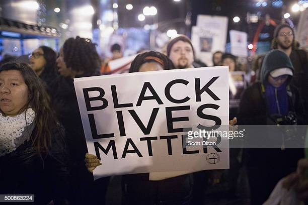 Demonstrators march through downtown calling fror the resignation of Mayor rahm Emanuel on December 10 2015 in Chicago Illinois Emanuel has come...