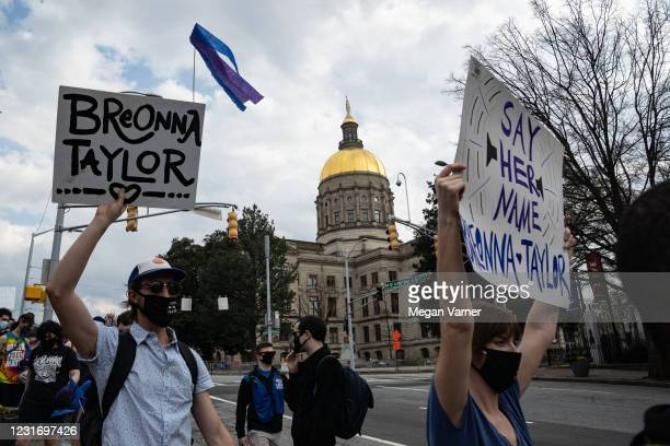 Demonstrators march through downtown in honor of Breonna Taylor on March 13, 2021 in Atlanta, Georgia. Today marks the one year anniversary of the...