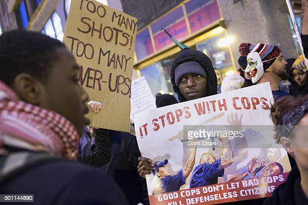 Demonstrators march through downtown on December 12 2015 in Chicago Illinois A recently released video showing the shooting of teenager Laquan...