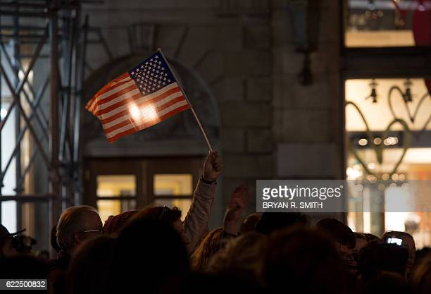 Demonstrators march through Manhattan to Trump Tower during a Love Rally march in New York on November 11 to protest the election of US...