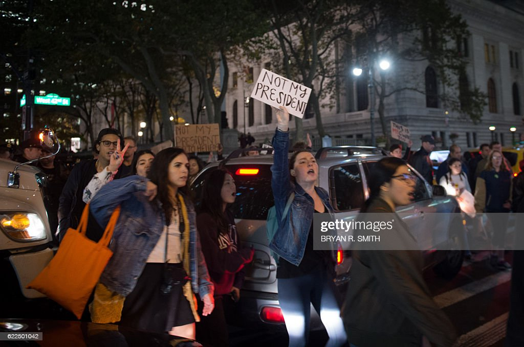 Demonstrators march through Manhattan to Trump Tower during a 'Love Rally' march in New York on November 11, 2016, to protest the election of US President-elect Donald Trump. / AFP / Bryan R. Smith