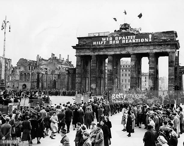 Demonstrators march through the Brandenburg Gate in Berlin on their way to a Communist rally in Lustgarten Square in 1948