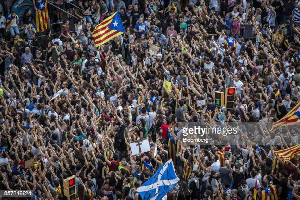 Demonstrators march through the city to protest against alleged police violence during Sunday's illegal referendum vote in Barcelona Spain on Tuesday...