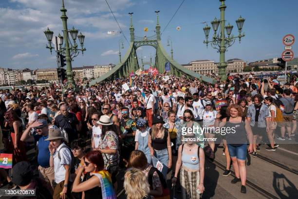 Demonstrators march through the Liberty Bridge during the annual Pride parade on July 24, 2021 in Budapest, Hungary. Pride organisers say that the...