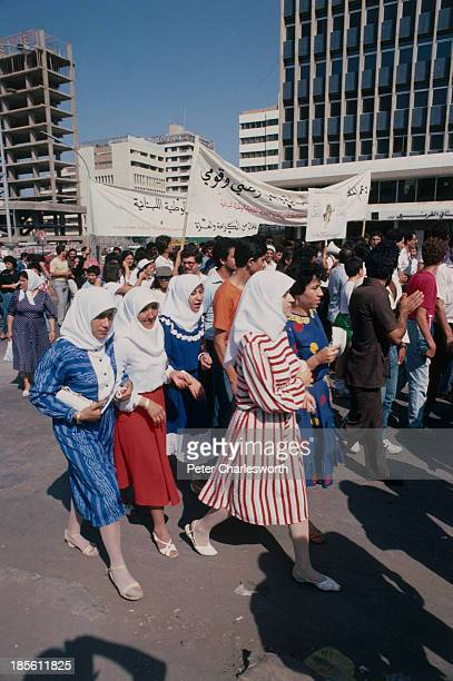 Demonstrators march through the streets of Beirut to protest the continued Israeli occupation of southern Lebanon. The Israel Defense Forces had...