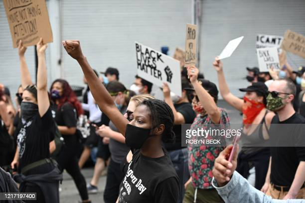 Demonstrators march through the streets of Hollywood California on June 2 to protest the death of George Floyd at the hands of police Antiracism...