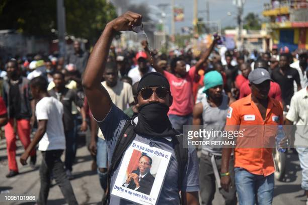Demonstrators march through the streets of PortauPrince on February 7 2019 Demonstrators demanded the resignation of Haitian President Jovenel Moise...