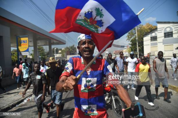 TOPSHOT Demonstrators march through the streets of PortauPrince on February 7 2019 Demonstrators demanded the resignation of Haitian President...