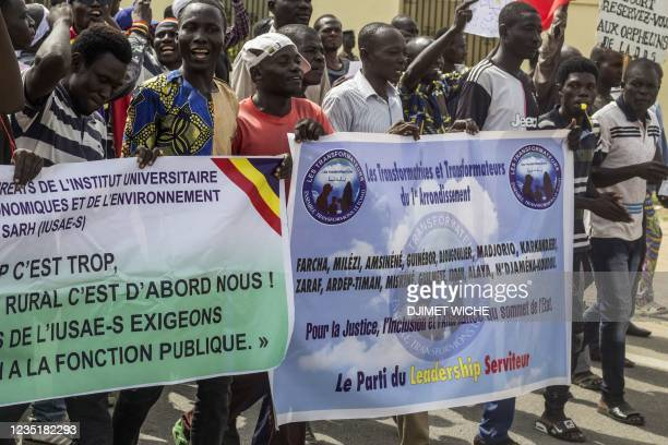 Demonstrators march through the streets of the Chadian capital N'Djamena on September 11 against the Junta that has ruled Chad since the death of...