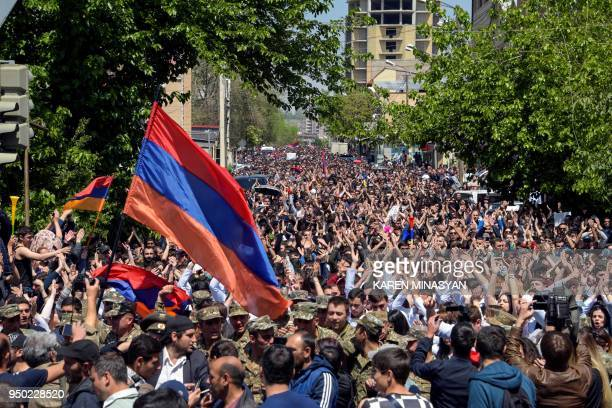 TOPSHOT Demonstrators march through the streets of Yerevan on April 23 to protest the former president's election as prime minister Hundreds of...