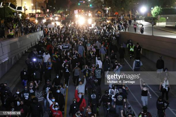 Demonstrators march through the streets on September 24, 2020 in Louisville, Kentucky. A Kentucky grand jury indicted one police officer involved in...