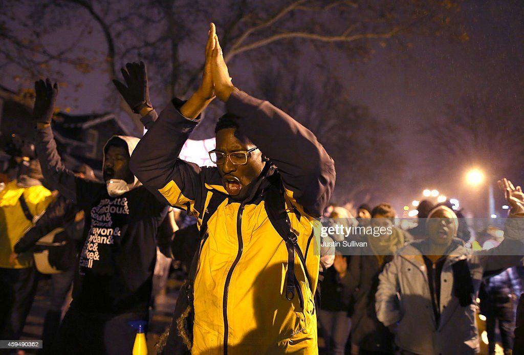 Demonstrators march through the streets while protesting the shooting death of 18-year-old Michael Brown on November 23, 2014 in St. Louis, Missouri. Tensions in Ferguson remain high as a grand jury is expected to decide this month if Ferguson police officer Darren Wilson should be charged in the shooting death of Michael Brown.