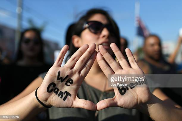 Demonstrators march through the Wynwood neighborhood to protest police abuse on December 7, 2014 in Miami, Florida. The protest was one of many that...