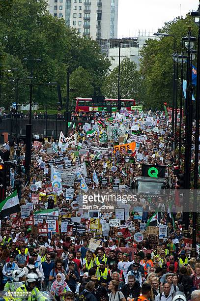 Demonstrators march through Westminster on September 12 2015 in London England The demonstrators are calling on David Cameron to accept more refugees...