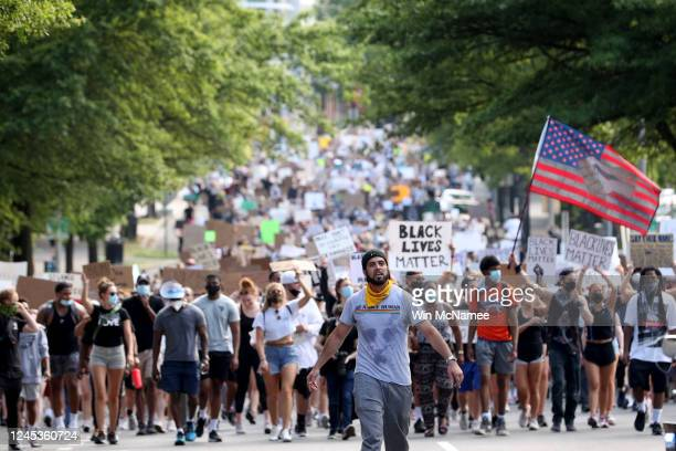 Demonstrators march to protest against police brutality and the death of George Floyd, on June 4, 2020 in the Clarendon neighborhood of Arlington,...