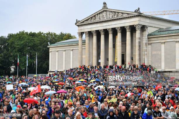 Demonstrators march to protest against the Bavarian Social Union the Bavarian Christian Democratic party on July 22 2018 in Munich Germany The...
